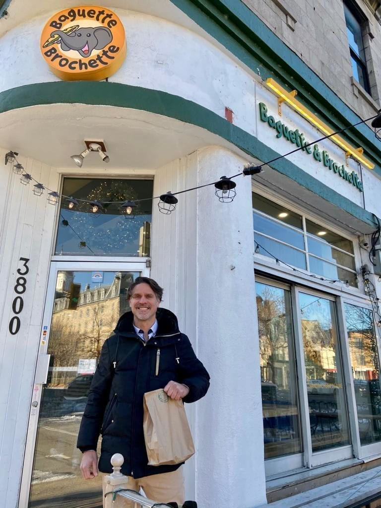 Our real estate broker Remy Babin in front of Baguette & Brochette, a restaurant on the Plateau Mont-Royal,