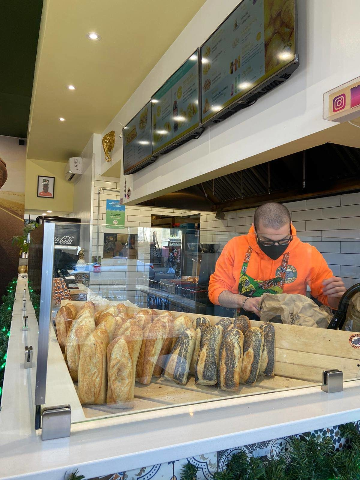 Fresh baguettes and the kitchen of Baguette & Brochette on the Plateau Mont-Royal.